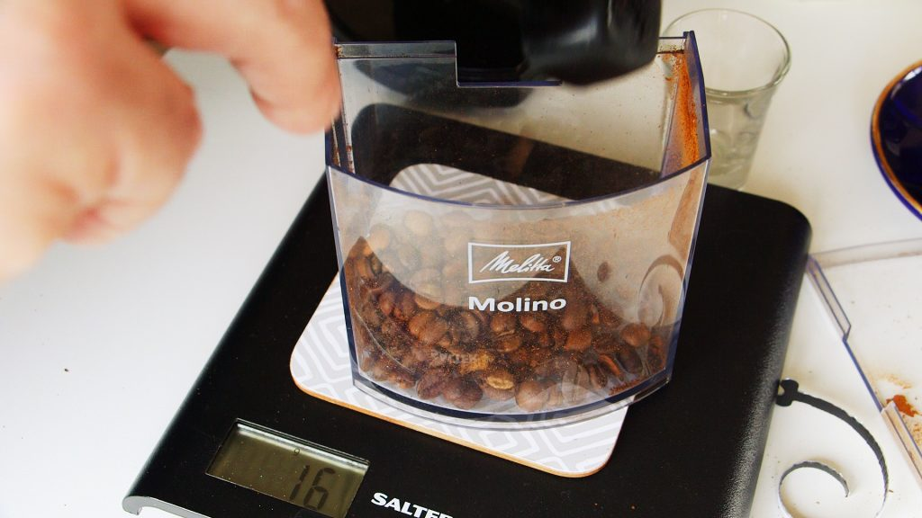 Melitta Molino Coffee grinder hopper on Salter Scales with James Gourmet Coffee Beans