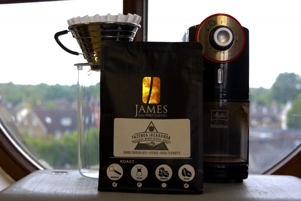 James Gourmet Coffee Beans with Kalita Wave 185 and Melitta Molino Coffee grinder with picturesque view.