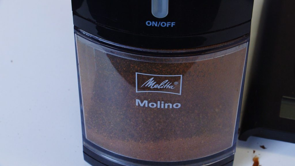 Melitta Molino Coffee grinder hopper midway through a grind.